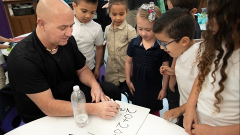 Tennis star Agassi was in Modesto Friday. How he's helping kids here fulfill their dreams