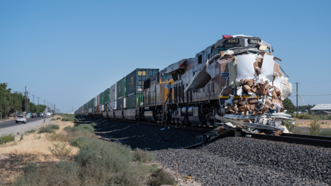 Semi carrying organic milk cartons hit by train after getting stuck on Turlock track