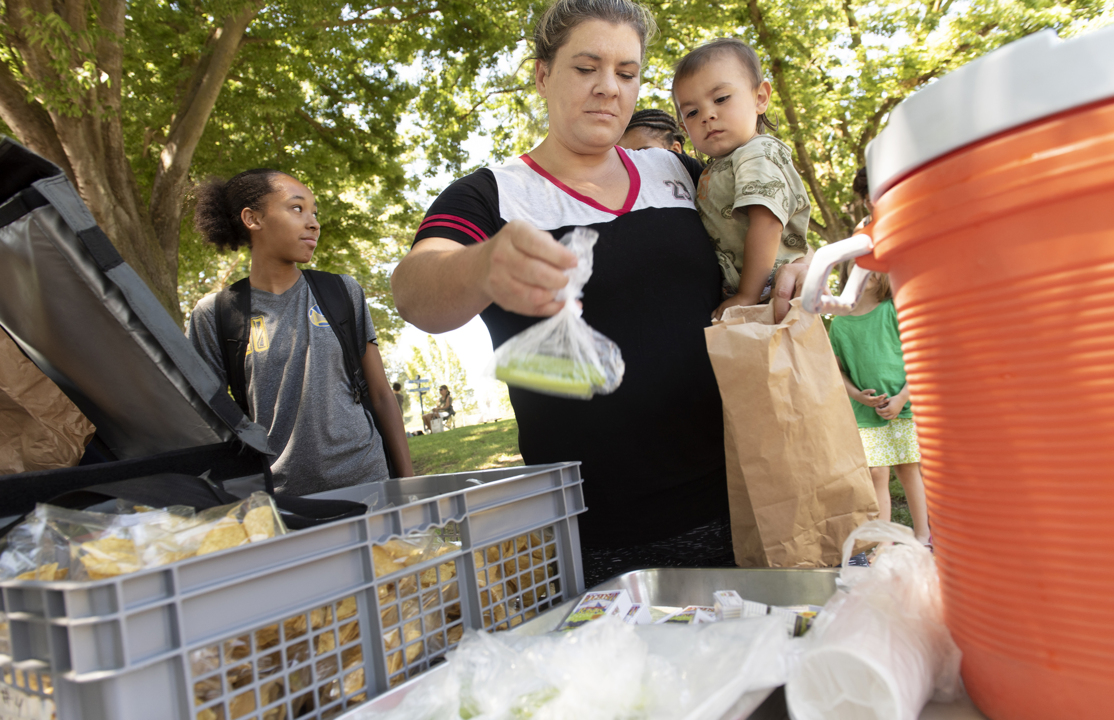 Free lunches don't end when school's out. Modesto's summer program adds books to mix.