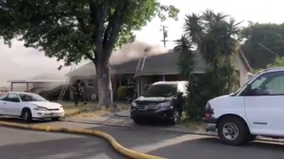 Crews battle fire on Somerset Drive in Modesto