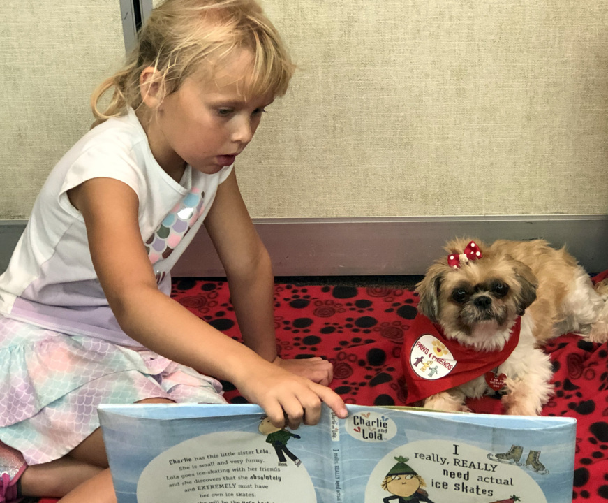 Has Oakdale Library gone to the dogs? No, but these canines help kids with reading anxiety