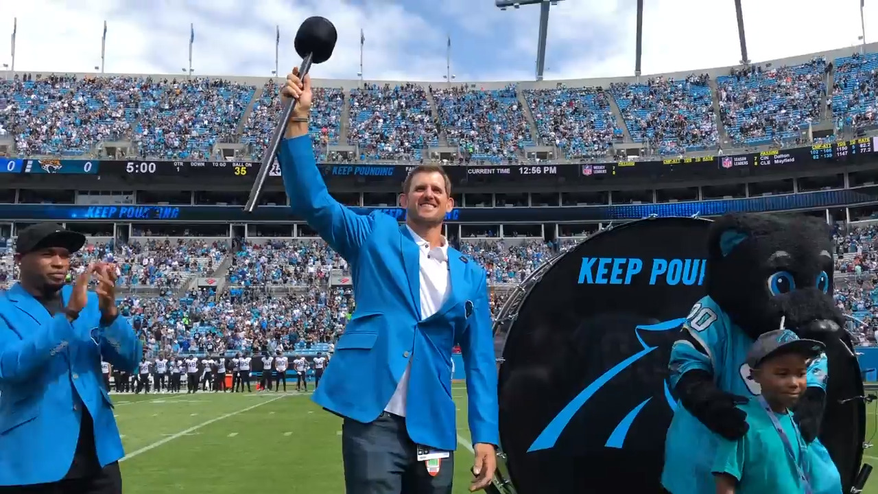 Panthers Hall of Honor inductee Jordan Gross hits the Keep Pounding drum