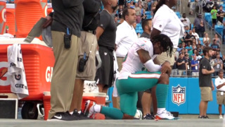 Miami Dolphins Albert Wilson takes a knee during national anthem before Panthers game