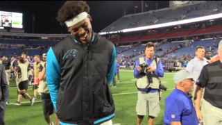 Panthers QB Cam Newton leaves field with a smile after win against Bills