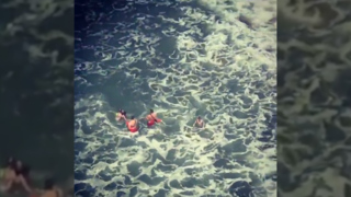 Watch as lifeguards save two people from rip currents on Venice Beach