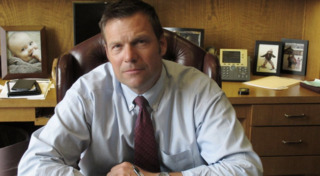 Kobach promised to help four cities on immigration. It cost them millions