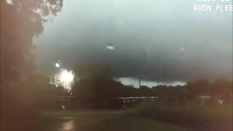 Powerful lightning bolts set off firework-like sparks caught on Missouri cop's dashcam