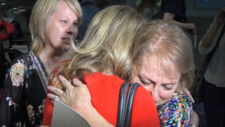 Sisters unite during emotional scene at KCI