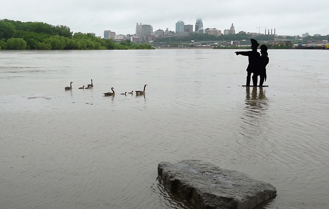 Flooding spreads across Kansas and Missouri as rains continue into Wednesday