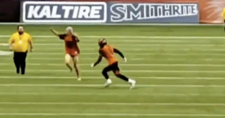 Streaker during CFL game gets leveled by defensive back