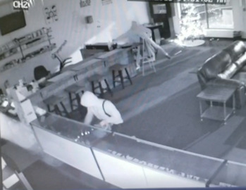 Surveillance video shows burglars smash window, ransack Shawnee vape store