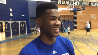 Why Ochai Agbaji quickly accepted a scholarship offer from KU