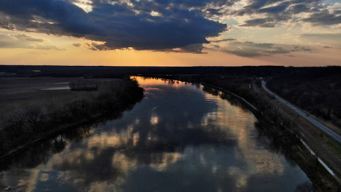 A moment of beauty in a time of turmoil-Take flight for a bird's-eye view of the tranquil Missouri River near sunset