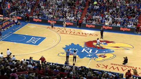 Watch former KU great Sherron Collins sink a half-court shot and make two people $5,000 richer during KU's Late Night in the Phog