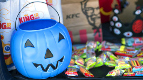 People don't get why her child won't say trick or treat. Could a blue pumpkin help?