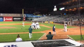 Pitcher rushes to console losing friend after striking him out for championship win