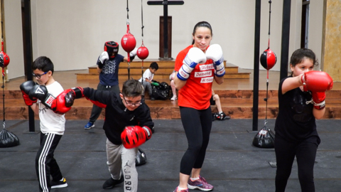Kansas Rep. Sharice Davids, a former MMA fighter, joins youth boxing class in KCK