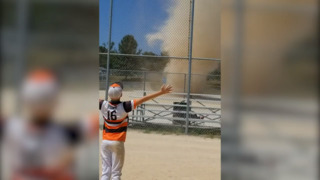 Dust devil interrupts youth baseball game in Oak Grove