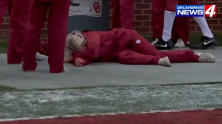 Oklahoma cheerleader rocked by errant pass to the face during Sooners spring game