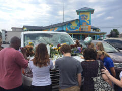 Mourners gather to pray in parking lot of 'Ride The Ducks' in Branson