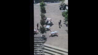 Watch as police arrive and fire at two men in downtown KC (no sound)