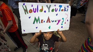 Rally at Sen. Blunt's office demands change in Trump family separation policy