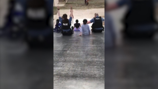 Watch as officers ride slide with kids in northeast KC