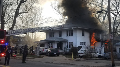 'Flames were shooting out': One injured in house fire on Oak Street in Kansas City