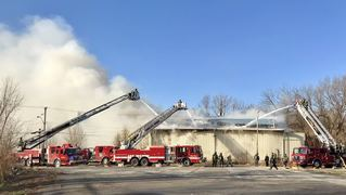 Two-alarm fire engulfs building near I-70 and Van Brunt in KC