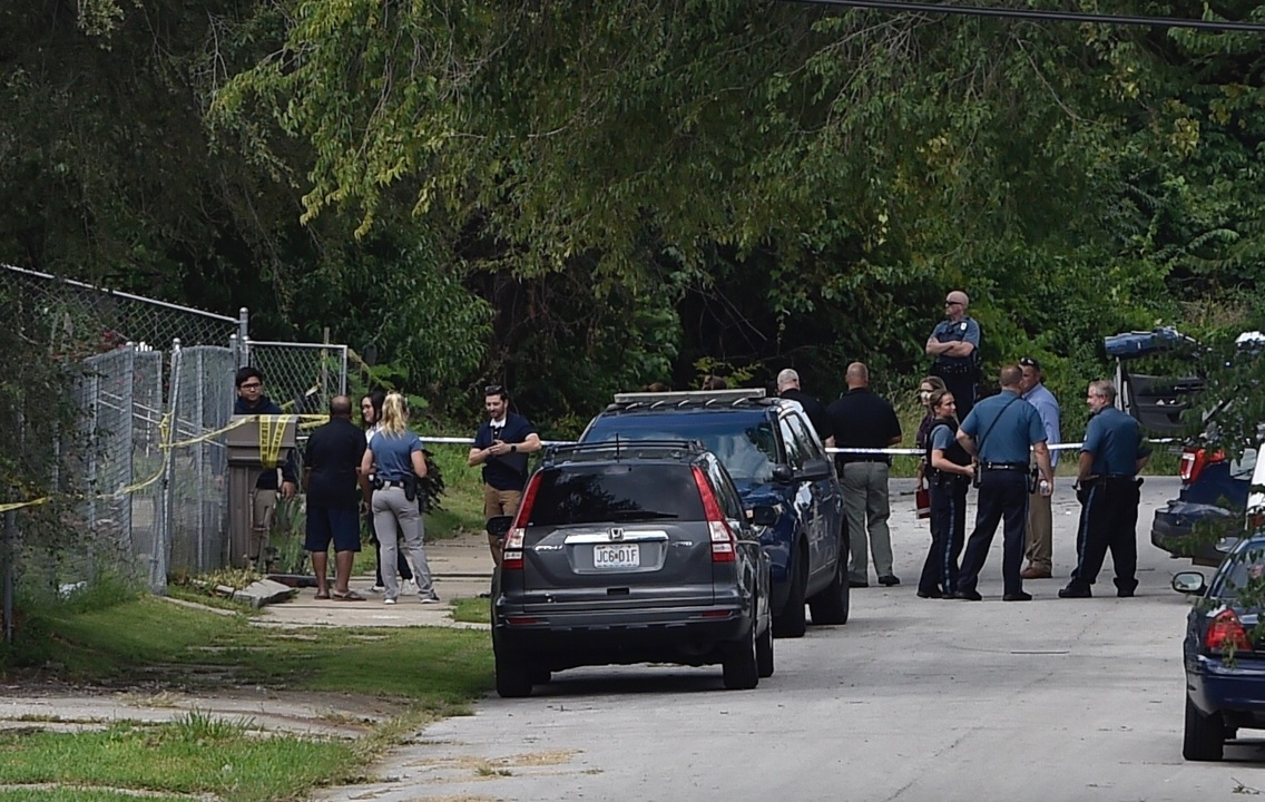 Image result for Off-duty officer shoots suspect in leg after gunfire leaves one dead and another hurt