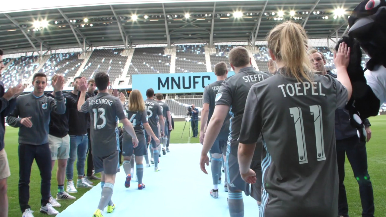 Unified players walk onto the field