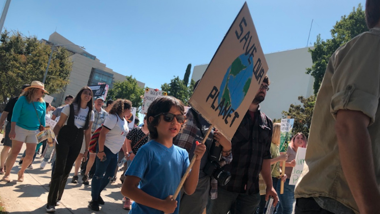 Young and old take to Fresno streets on worldwide day of strikes for climate action