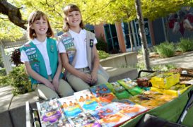 Girl Scout sisters show off their first place cookie-selling skills