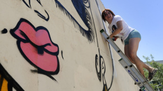 LA muralist Sand One creating art in downtown Fresno