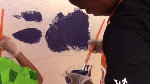 Webster Elementary students work on painting tiger paws