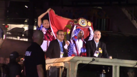 Marine veteran gets a grand entrance on 'his' weekend, then backs it up in ring to defend belt