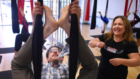 Watch a Bee reporter try aerial yoga