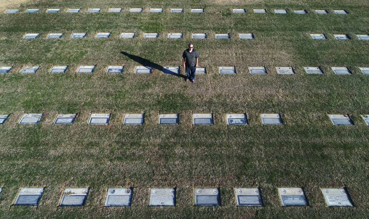 He spends nearly all his time at his wife's grave. Then he began doing more at the cemetery