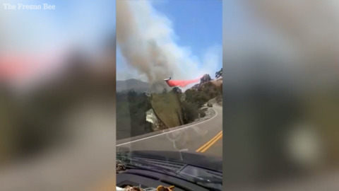 Driver, friend come up on air tanker dropping fire retardant near Dunlap