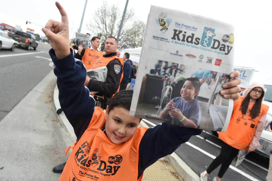 Rain doesn't dampen enthusiasm as about 8,000 volunteers fan out to sell Kids Day papers