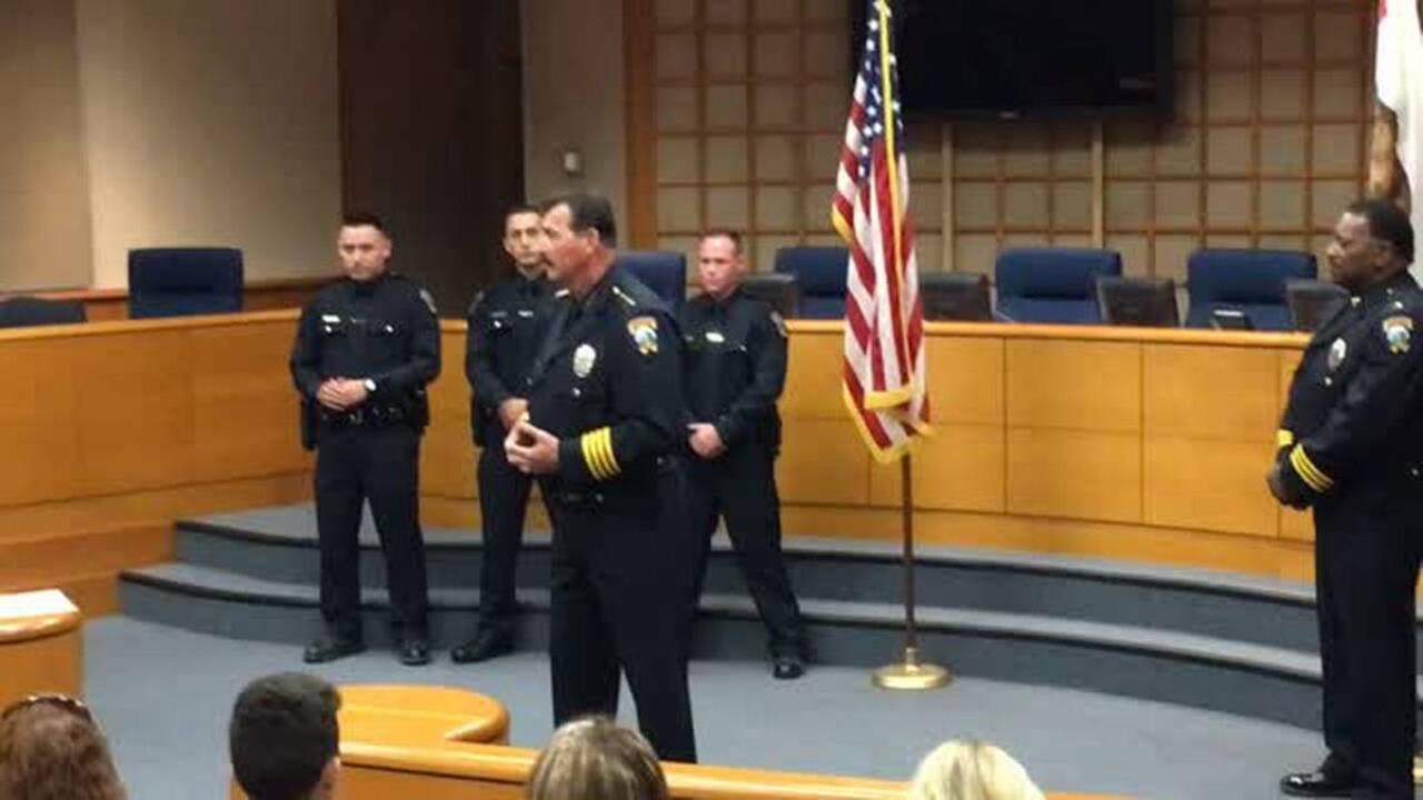 Merced up to officers after ceremony at city hall