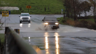 Watch cars drive through rushing water on San Luis Bay Drive in Avila Valley