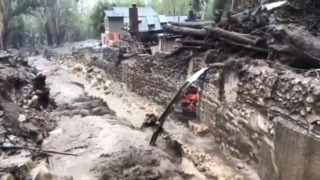 Water rushes down Montecito Creek where mudslides hit in Santa Barbara County
