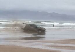 SUV spins its wheels after getting stuck on beach near Oceano