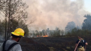 DNR helicopter helps fight fire with water drops