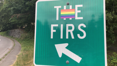 Protesters gather outside of The Firs in support of camp counselor fired for being gay