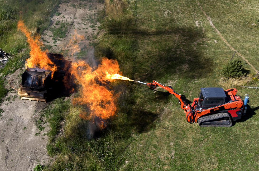 Why would this Whatcom company mount a flamethrower on a skid steer? Because it could.