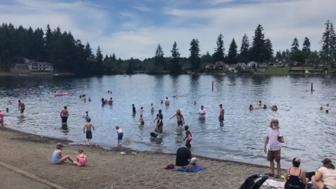 Heat wave brings record temperatures as people try to stay cool