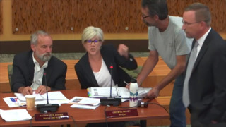 Olympia City Council meeting interrupted as pair tries to deliver lawsuit to mayor