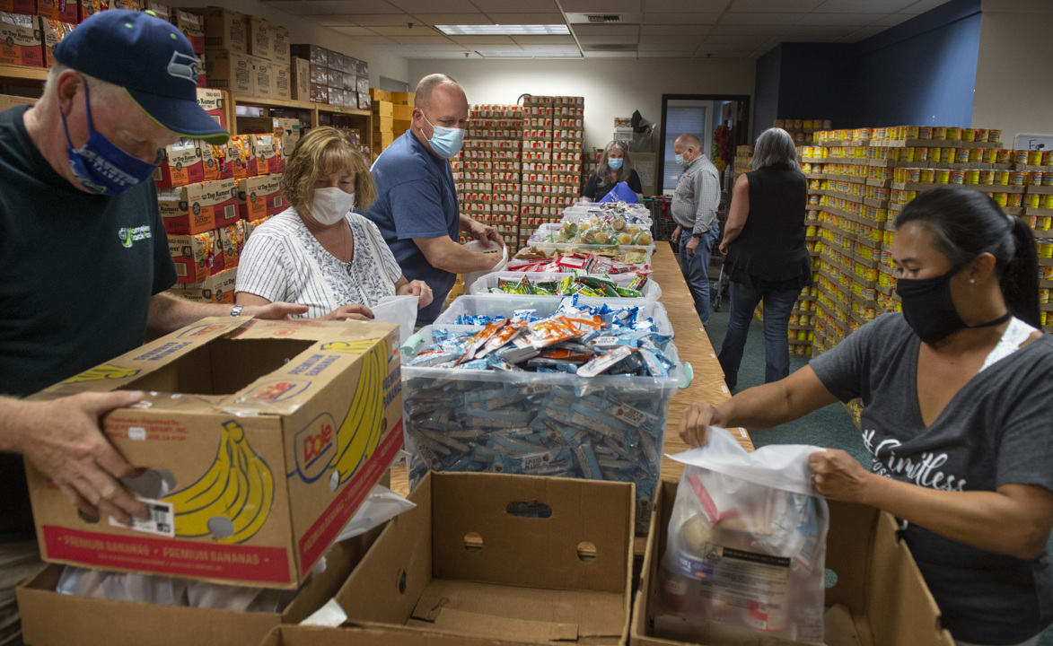 Homeless Backpacks volunteers bag 7,400 meals in 24 hours to feed families this summer